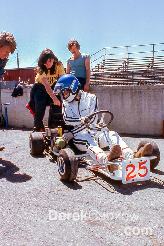 1976, Capital City Speedway -- Jean Joinette helping start my engine with an external starter. She and Jane Murray, Jane Wagner back then, used to lead the pack on the track when I first arrived and it took me about six months to gain the speed to reel them in! Note the little box muffler on the engine -- these were mandated to try and keep the cost of running down. They didn't muffle much though... — at Capital City Speedway.