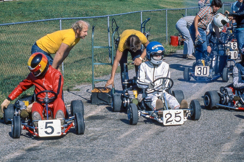 Dave Elliot (#5), Derek Cadzow (#25). Allan McRory yellow shirt, back left, and Paul Joinette yellow shirt, back right. Paul and Al ran McEtte Enterprises that supplied the Ottawa area with competition karting equipment and brought Dave and I to Goodwood at the end of the 1976 season.